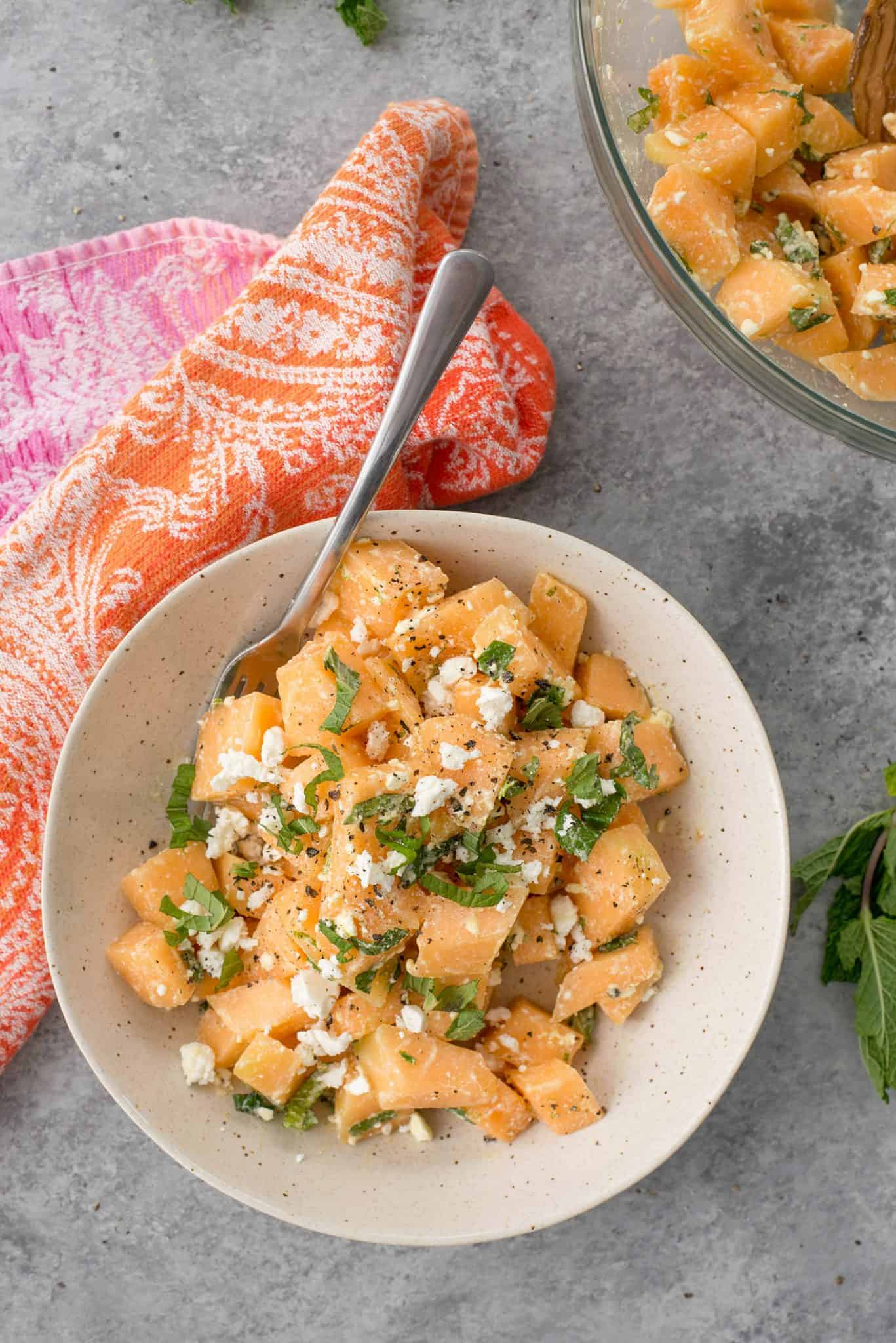 Melon, Mint and Feta Salad! This is the perfect sweet and salty combination. Great side-dish for summer, potlucks and cookouts. Cubes of melon, feta, mint and a lime dressing. Vegetarian and Gluten-Free.   delishknowledge.com