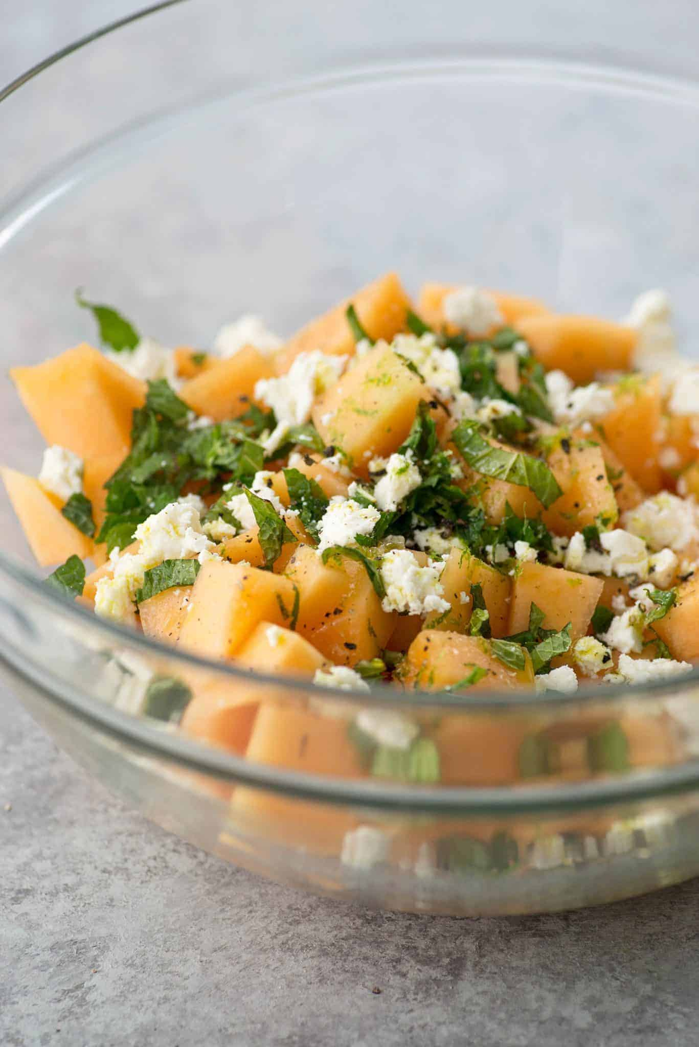 Melon, Mint and Feta Salad! This is the perfect sweet and salty combination. Great side-dish for summer, potlucks and cookouts. Cubes of melon, feta, mint and a lime dressing. Vegetarian and Gluten-Free. | delishknowledge.com