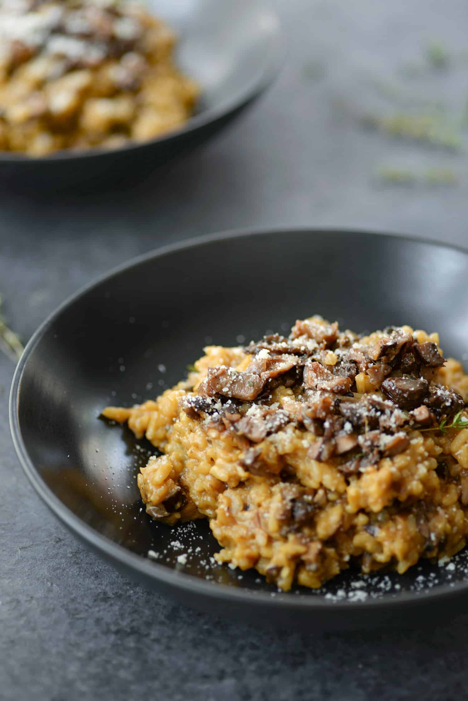 Wild Mushroom Risotto! If you love risotto, you've gotta try this recipe. Homemade wild mushroom stock with crispy, thyme roasted mushrooms with creamy risotto. Vegetarian, easily vegan. | www.delishknowledge.com