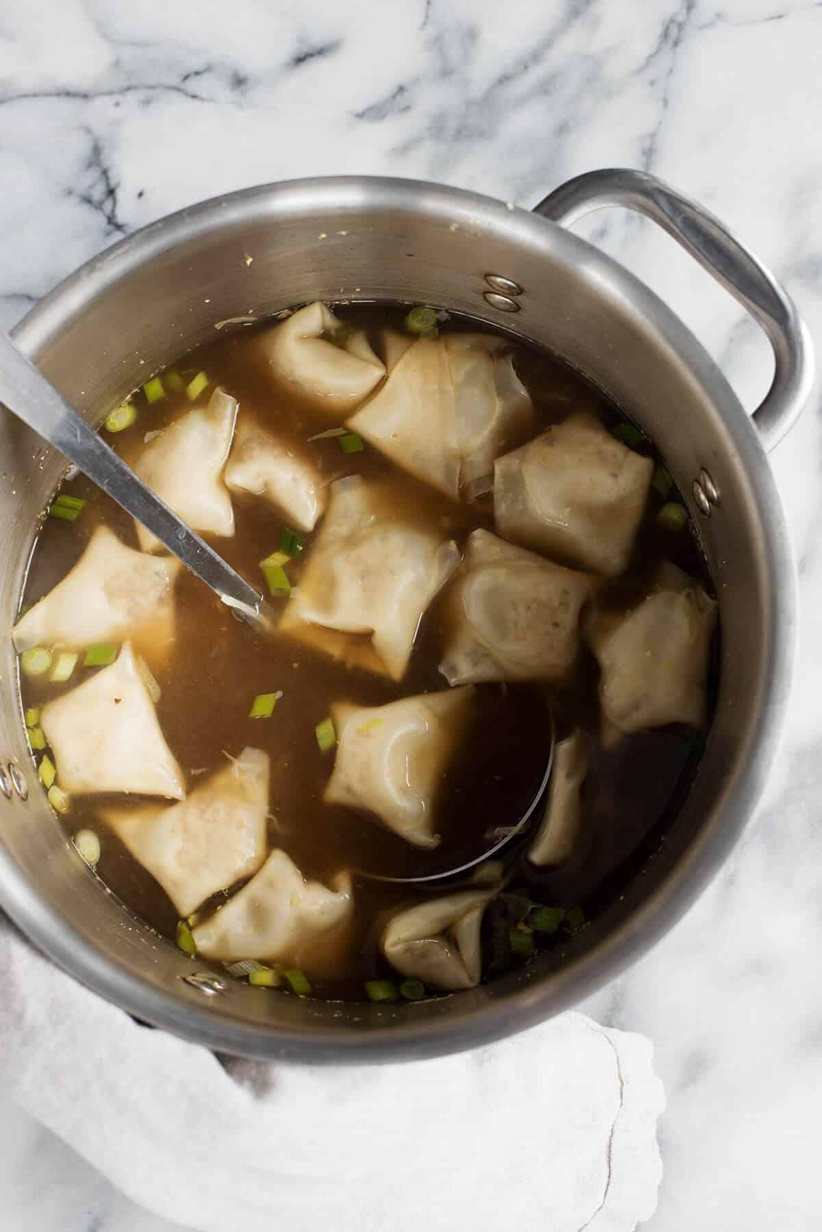 Mushroom Wonton Soup! Homemade wontons with mushrooms and tofu served in a rich mushroom broth. A vegetarian and vegan must! | www.delishknowledge.com
