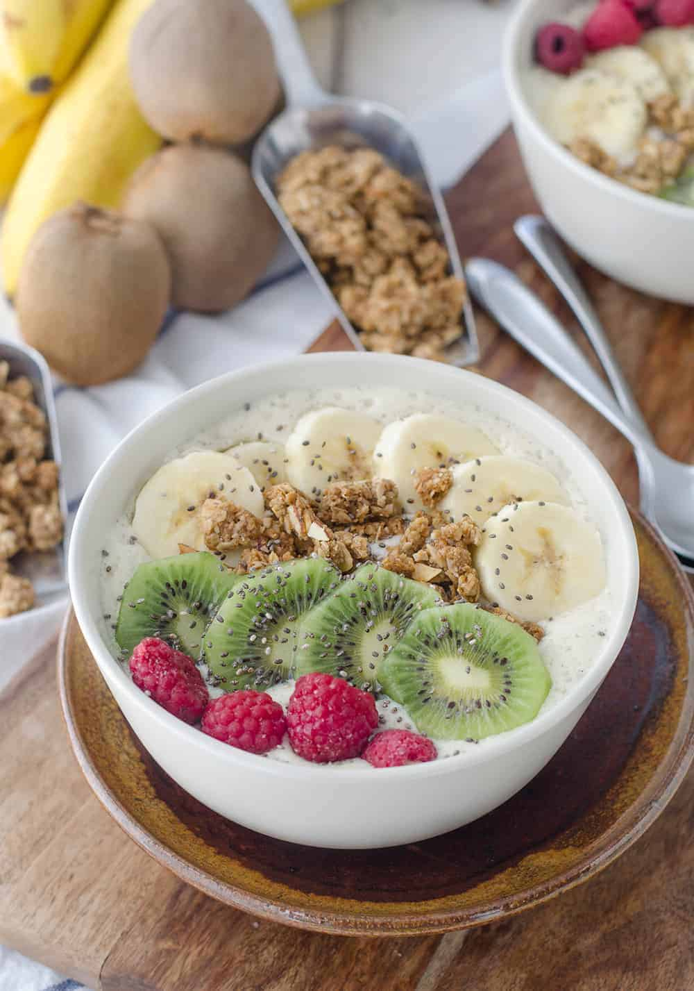 New Zealand Inspired Smoothie Bowls! Kiwi Vanilla Smoothie Bowls topped with Hokey Pokey Granola. A healthy breakfast, packed with almost 20 grams of protein. | www.delishknowledge.com