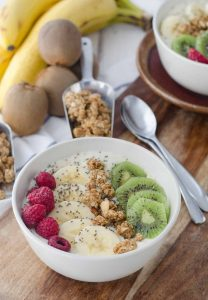 New Zealand Inspired Smoothie Bowls! Kiwi Vanilla Smoothie Bowls topped with Hokey Pokey Granola. A healthy breakfast, packed with almost 20 grams of protein.   www.delishknowledge.com