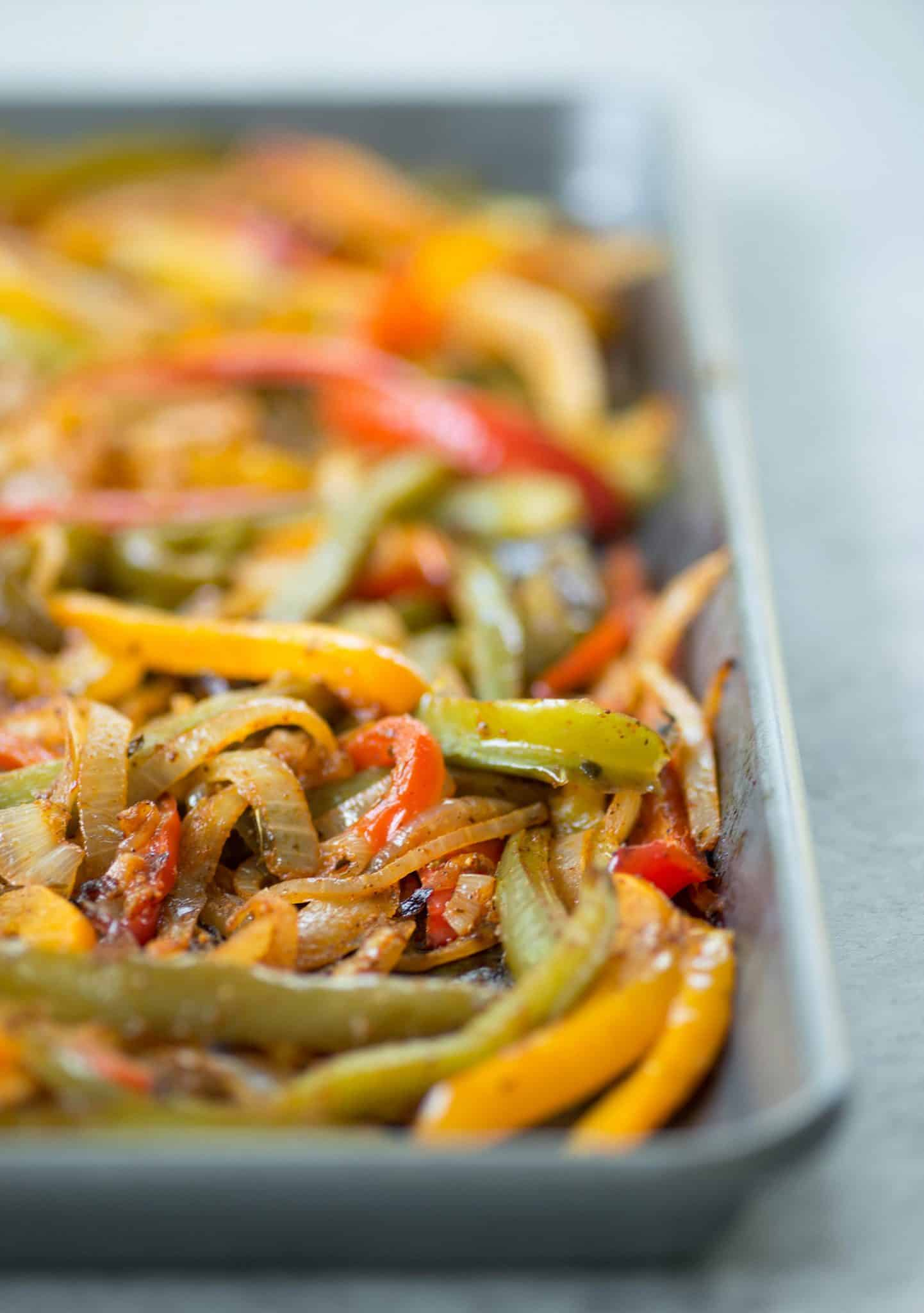 Oven Roasted Fajitas! These veggie fajitas are such a simple meal. Throw everything in the oven and dinner is ready in just 30 minutes. Customize them however you like 'em. | www.delishknowledge.com