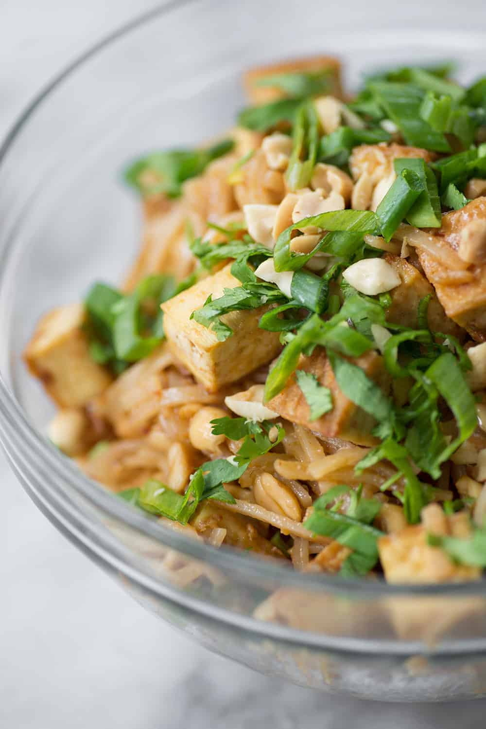 bowl of spicy peanut noodles and tofu