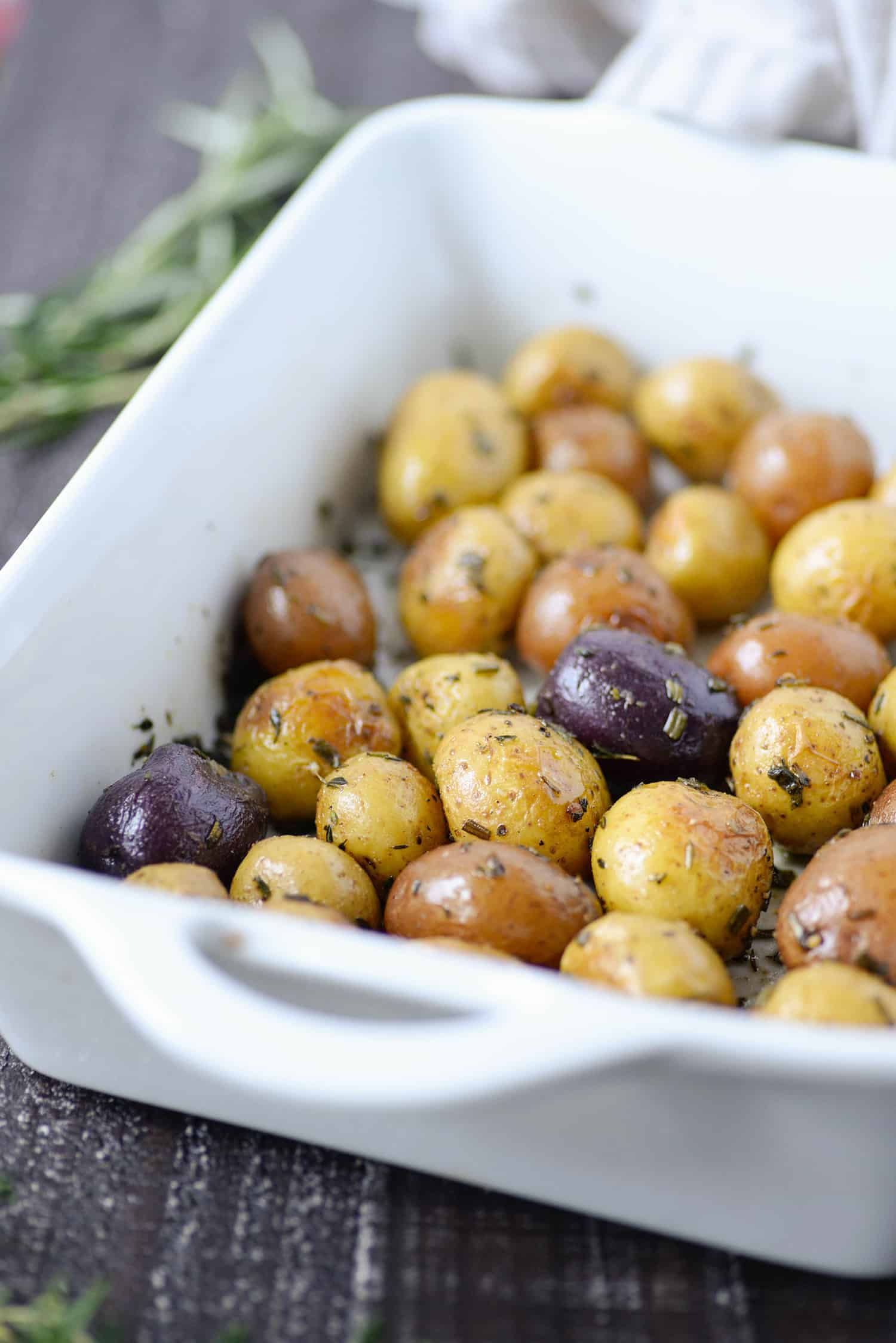 Perfect Herb Roasted Potatoes. These recipes are roasted with sage, rosemary and thyme. Perfect for #thanksgiving, the #holidays or any simple table! #Vegan and #Glutenfree. #healthy #vegetarian #sidedish #christmas #recipes #healthyrecipe | www.delishknowledge.com