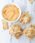 Pizza crackers with homemade pizza hummus! Ready in just 30 minutes! A healthy snack, kid approved! Vegan | delishknowledge.com