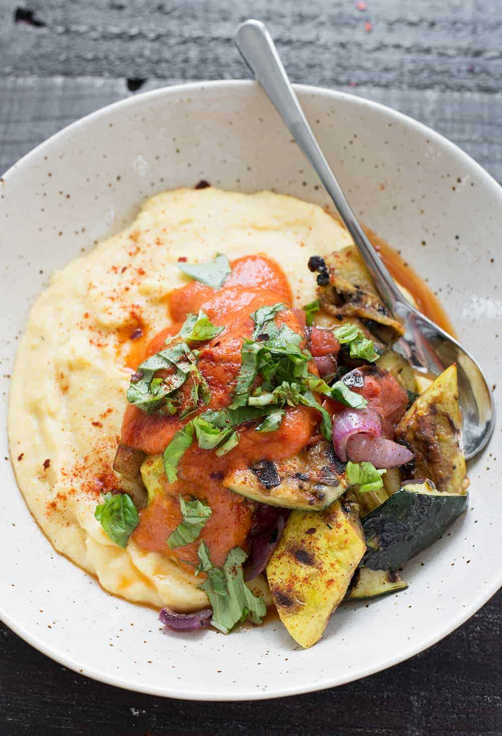 vegan polenta with grilled vegetables and red pepper sauce