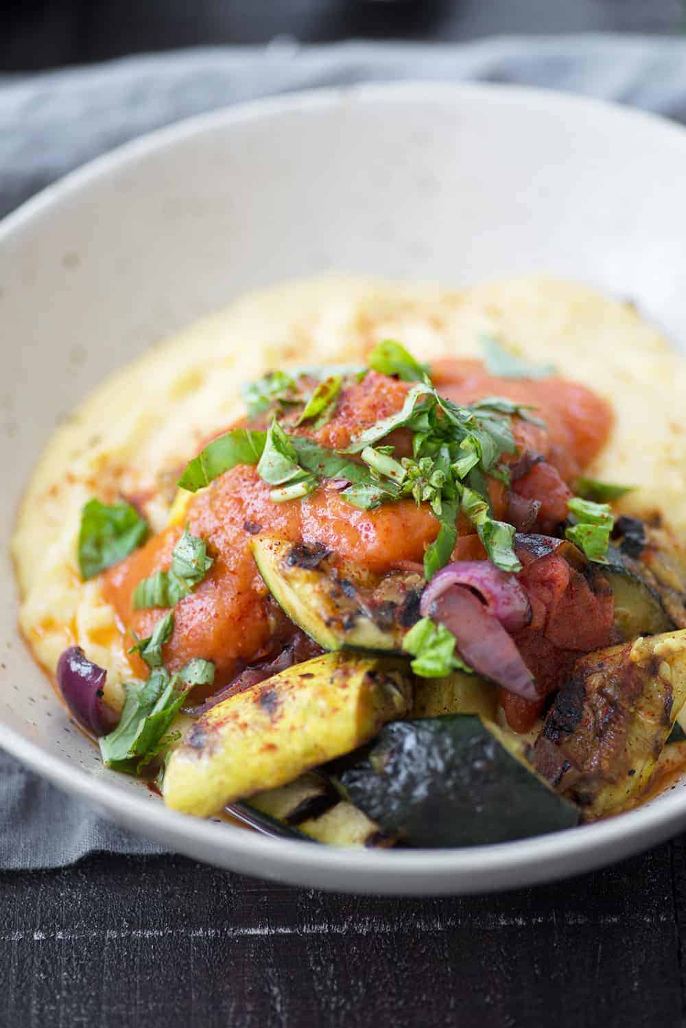 creamy polenta with grilled summer vegetables and homemade roasted red pepper tomato sauce