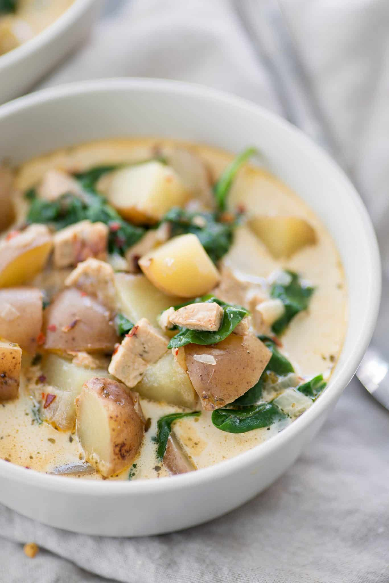 Potato, Spinach and Sausage Soup. You are going to love this vegan and gluten-free soup! Similar to Olive Garden's zuppa toscana, but healthier! | www.delishknowledge.com