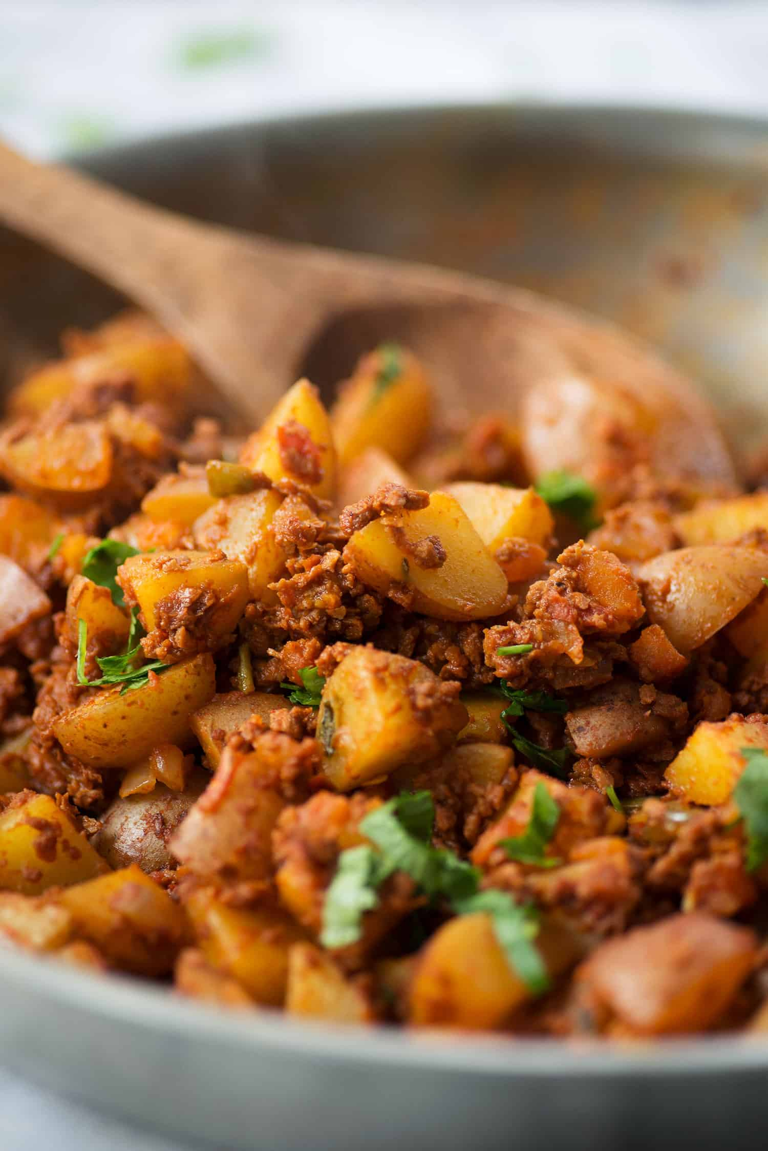 skillet with crispy potatoes and soyrizo