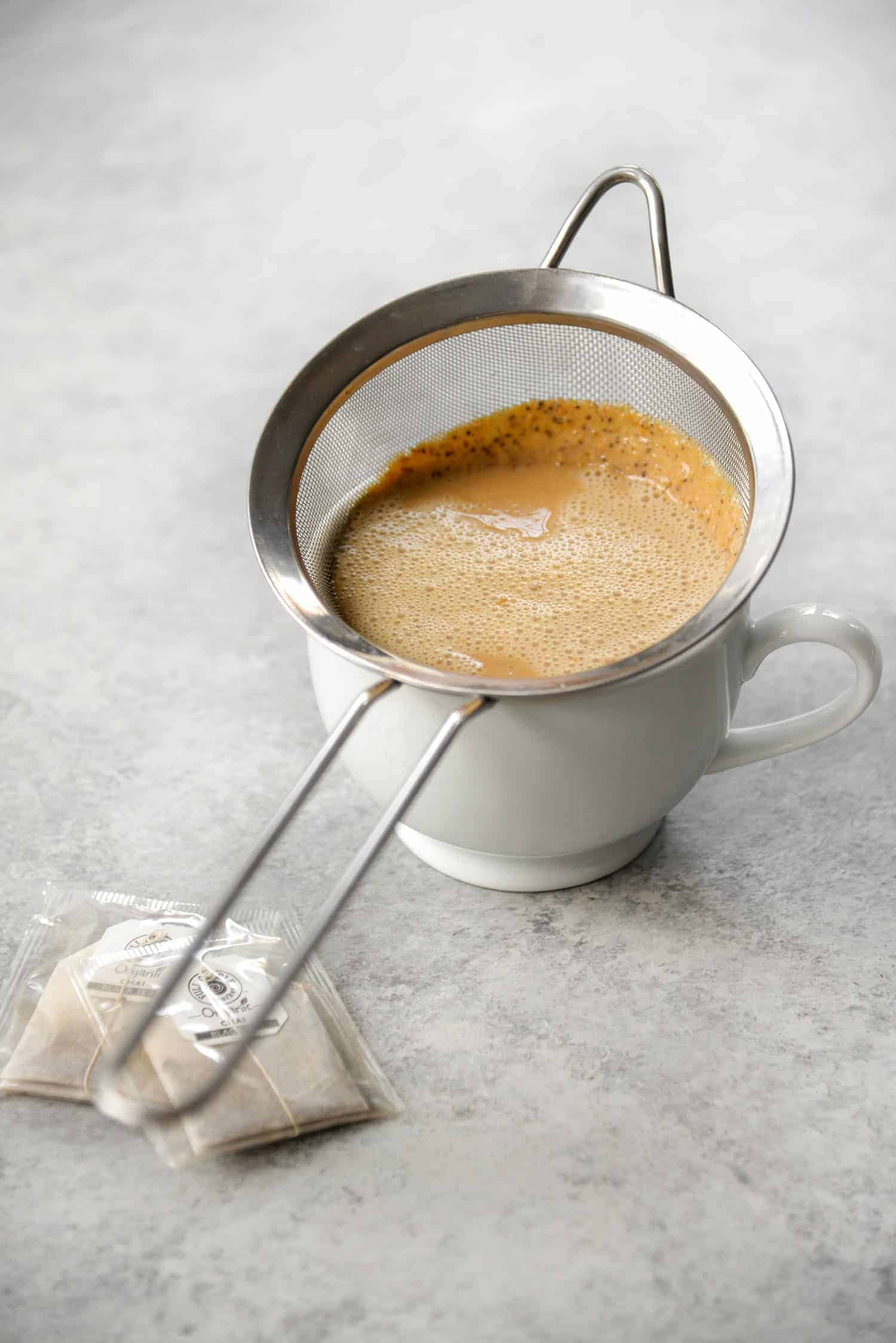 Pumpkin Chai Latte for One! If you love pumpkin chai lattes, you'll want to save this healthier, cleaner version. Made with chai tea, pumpkin puree, almond milk and spice. Vegan & Gluten-Free | www.delishknowledge.com