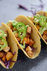 Roasted Butternut Squash and Tofu Tacos with Avocado Cream Sauce. These #vegan and #glutenfree tacos are amazing! Roasted chipotle squash and tofu in corn tortillas with shredded red cabbage and avocado cream sauce. A must make! | www.delishknowledge.com| #tofu #butternutsquash #vegan #vegetarian #glutenfree #tacotuesday #healthy #tacos #mexican