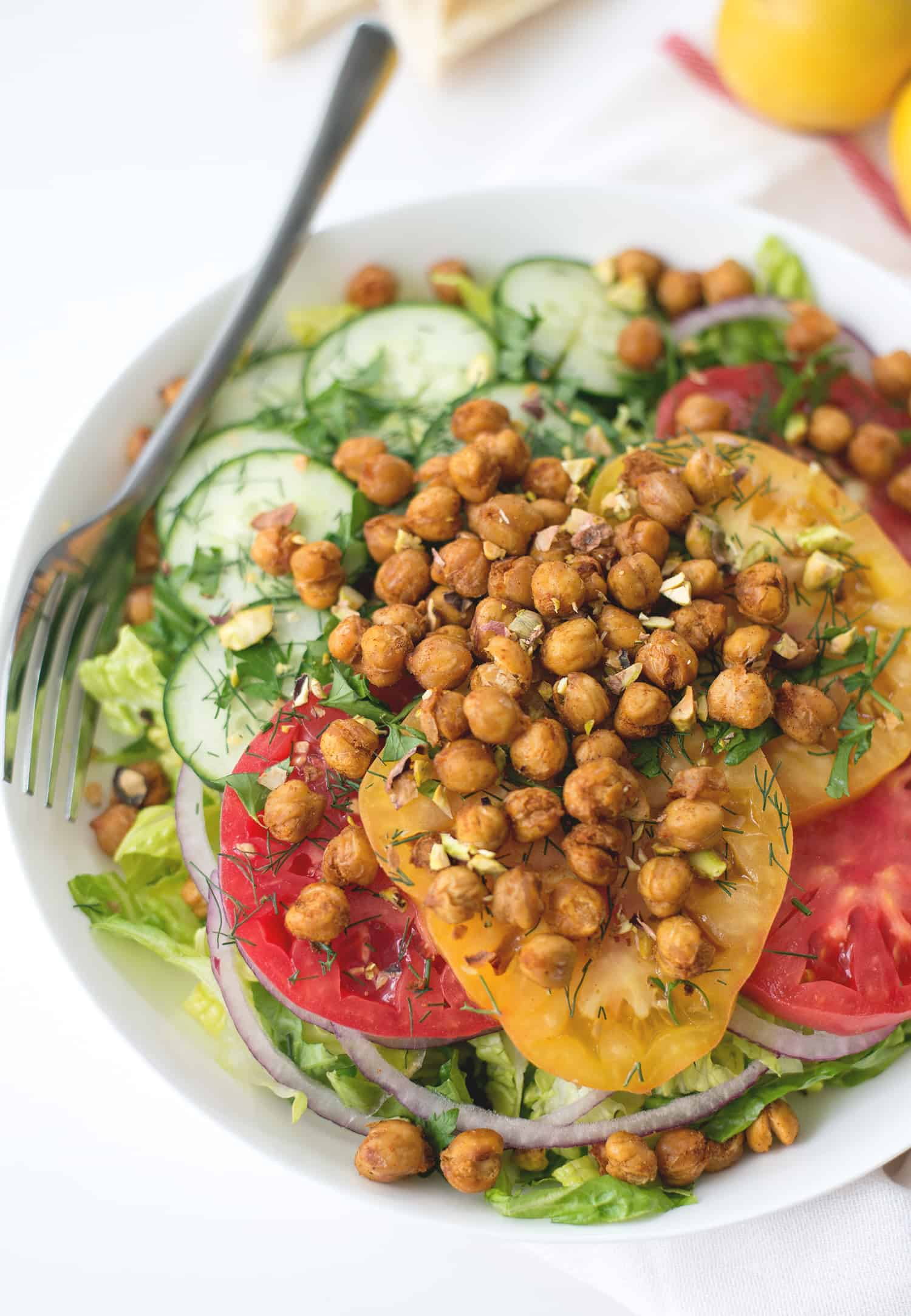 Roasted Chickpea Salad with Hummus Dressing! Crispy, seasoned roasted chickpeas in a yummy salad and a hummus-dill dressing. Vegan & Gluten-Free | www.delishknowledge.com