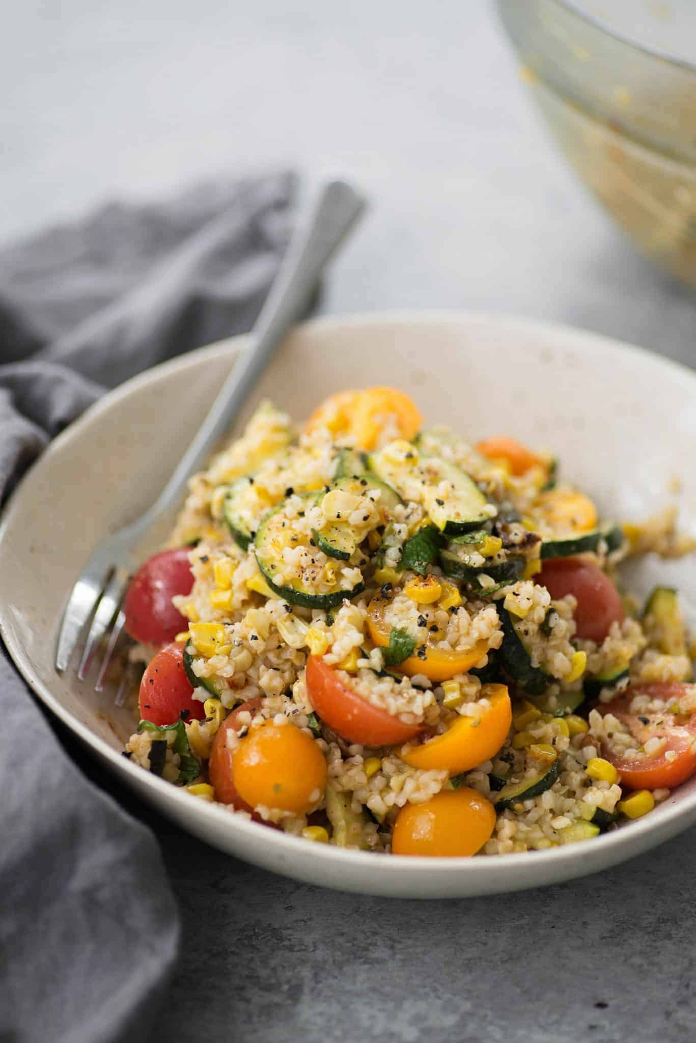 Roasted Zucchini, Corn and Bulgur Salad with Lemon Dressing. This healthy side dish is perfect for summer, potlucks and cookouts. Vegan | delishknowledge.com