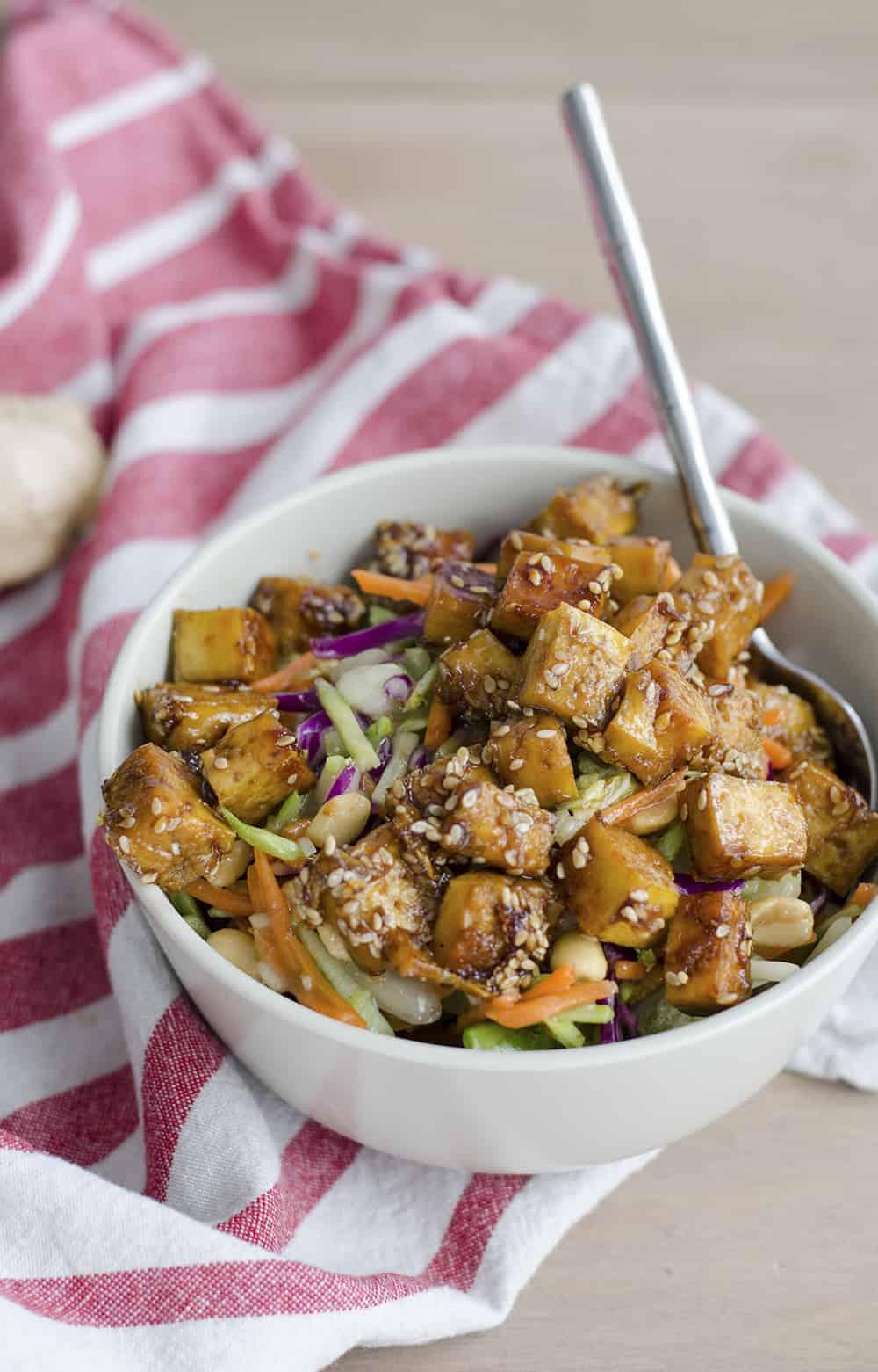 Sesame Ginger Chopped Salad! Crispy sesame-ginger tofu with Eat Smarts Ginger Bok Choy Salad greens! An easy way to enjoy a restaurant quality salad at home. Vegan and Vegetarian | www.delishknowledge.com