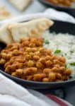 Slow Cooker Vegan Chana Masala. Chickpeas cooked in a fragrant, spiced tomato sauce. Make in the morning for dinner at night! Vegan and Gluten-Free | www.delishknowledge.com