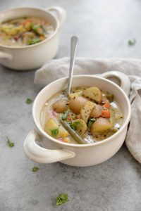 Slow Cooker Vegetable Chowder! Save this vegan and gluten-free meal when you want an easy dinner option. Start in the morning and it's ready by the time you get home from work. Potatoes and vegetables in a creamy sauce. | www.delishknowledge.com
