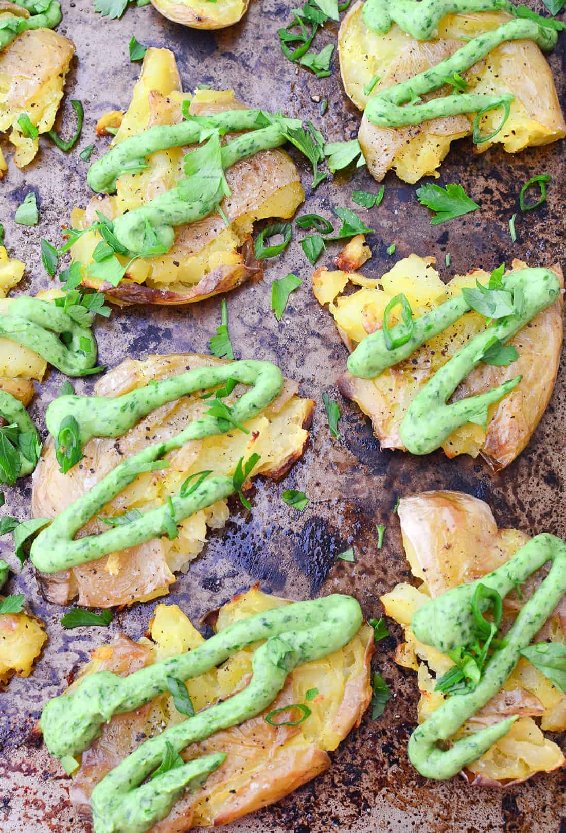 Crispy Smashed Potatoes with Creamy Chimichurri Sauce! You'll want to bring this to your next cookout or potluck! Vegan and Gluten-Free | www.delishknowledge.com