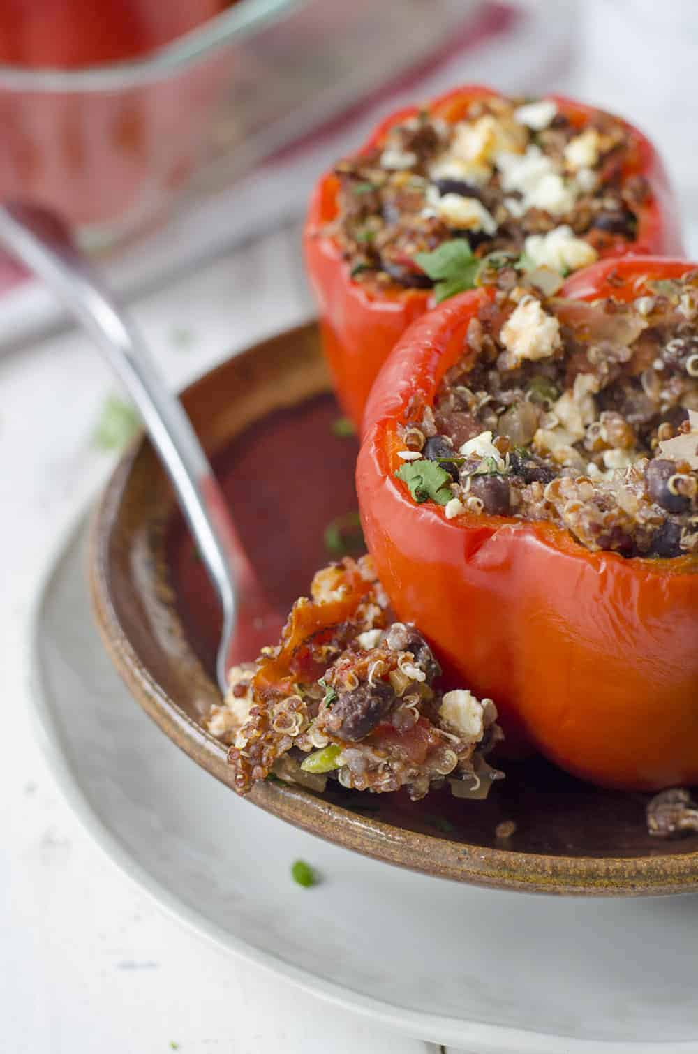 Southwestern Quinoa Stuffed Peppers! Vegetarian and Gluten-Free! These protein packed peppers are so easy to put together and perfect for busy weeknights. Save these to make later! | www.delishknowledge.com