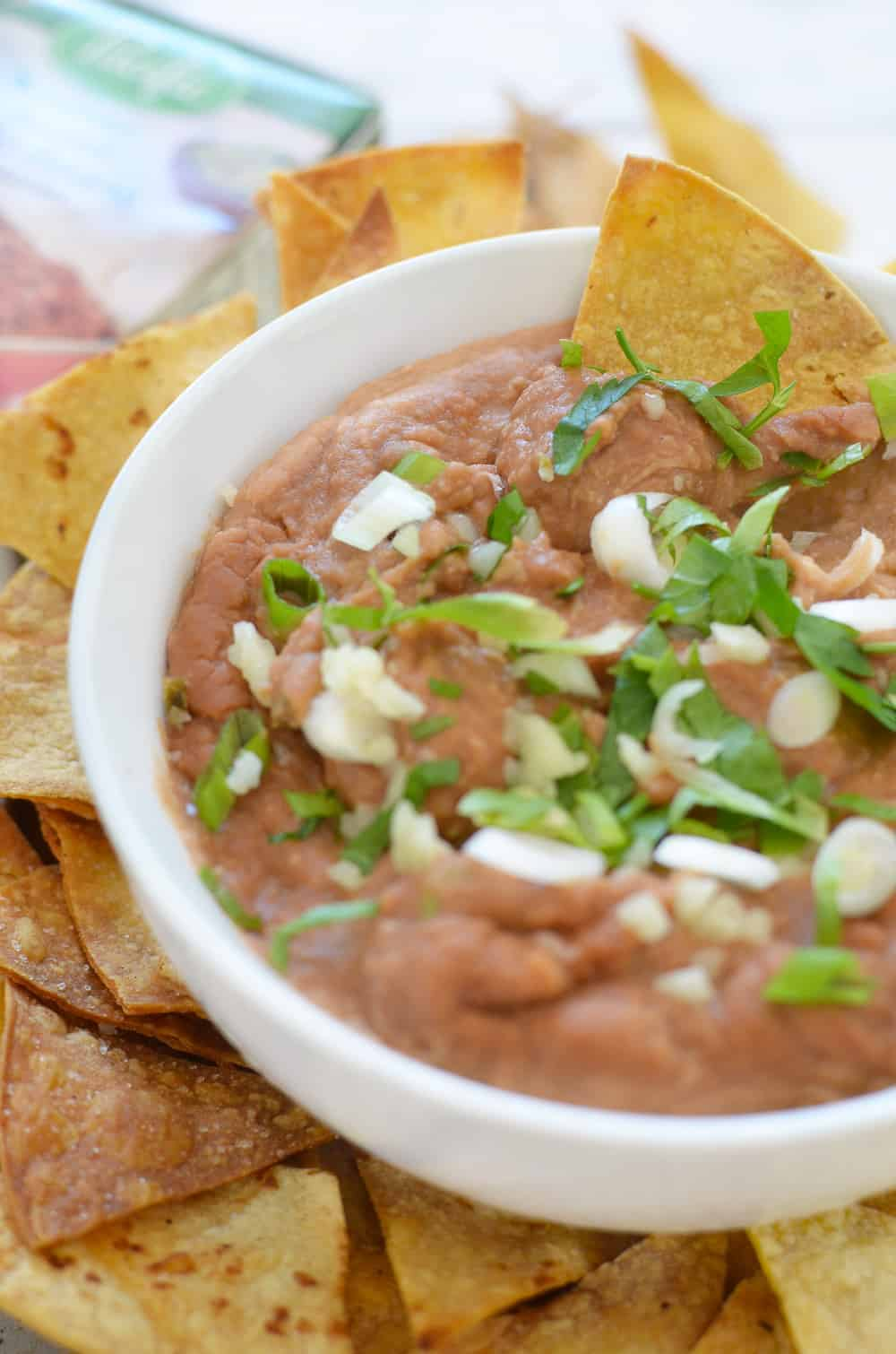 15 minute Spicy Bean Dip with Homemade Tortilla Chips! A must-make for tailgates, football games, and parties! Save this one when you need a fast, healthy appetizer option. #vegetarian #glutenfree | www.delishknowledge.com