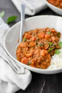 Spicy Coconut Curry Lentils! These lentils are the perfect quick weeknight meal. Curried lentils in a tomato coconut sauce, ready in just 30 minutes! #vegan and #glutenfree | www.delishknowledge.com