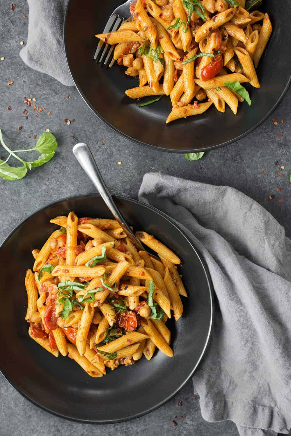 two bowls of vegan penne pasta