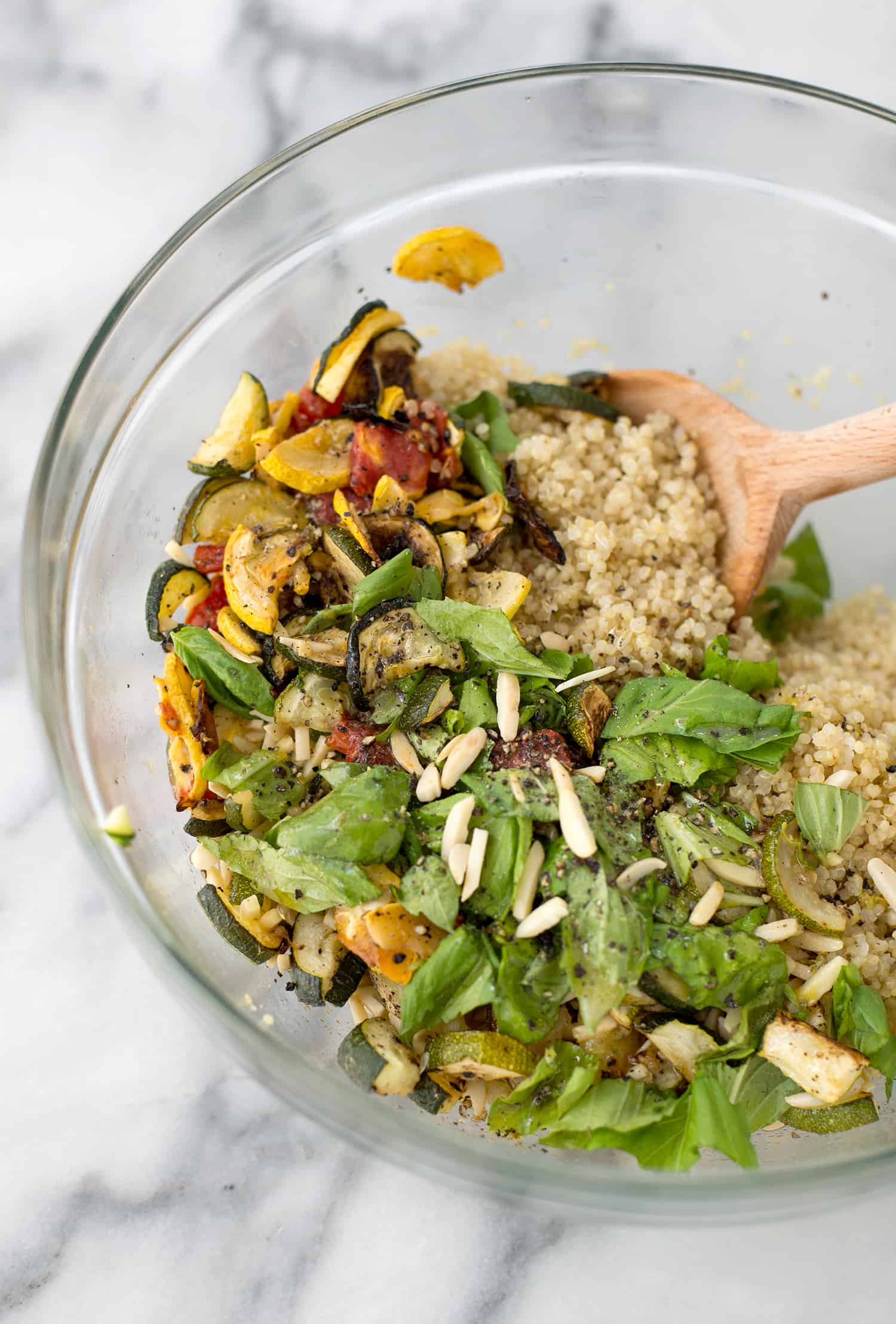 Roasted Summer Squash and Quinoa Salad! This side dish is perfect for summer or dinners. Roasted zucchini, squash and tomatoes with quinoa and a lemon-basil dressing. Vegan and GlutenFree | www.delishknowledge.com