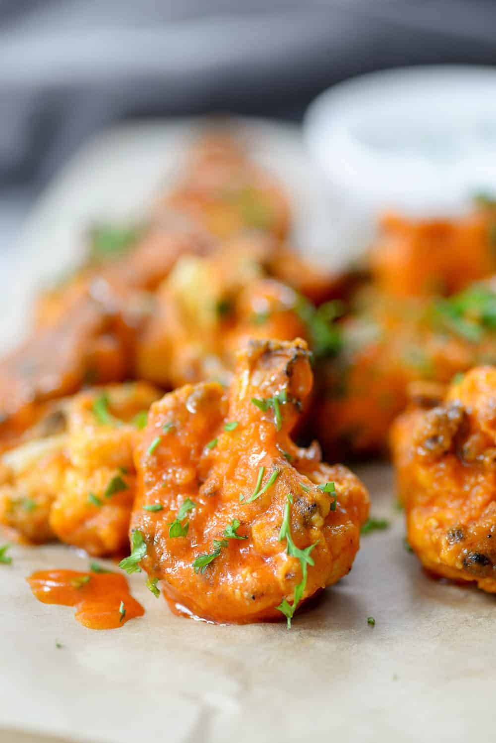 close up of sriracha cauliflower buffalo wings