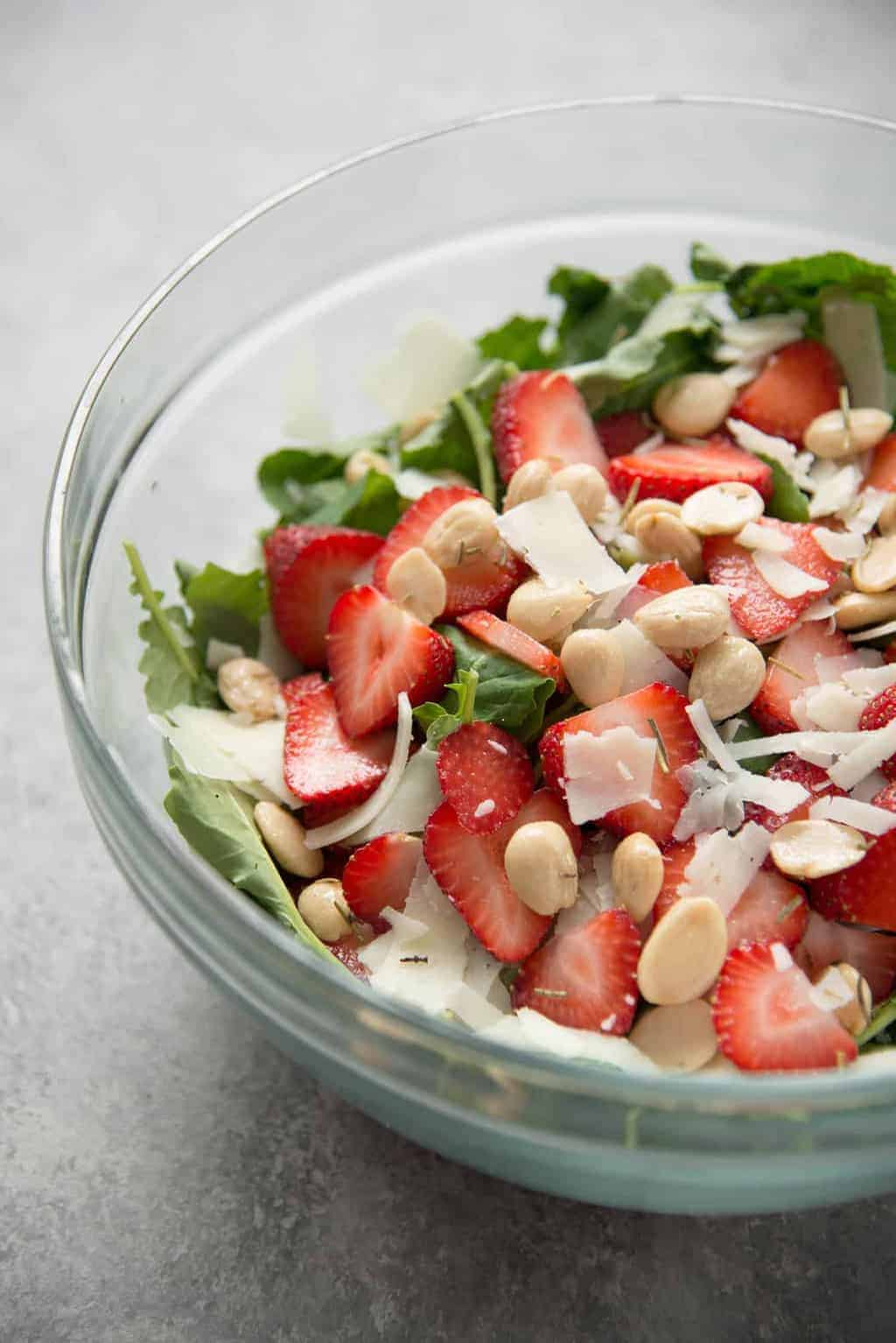 Strawberry Kale Salad with Lavender Dressing. You've gotta try this healthy salad, perfect for summer! This lavender-poppy seed dressing is so delicious, it's great on everything. Vegetarian and Gluten-free | www.delishknowledge.com