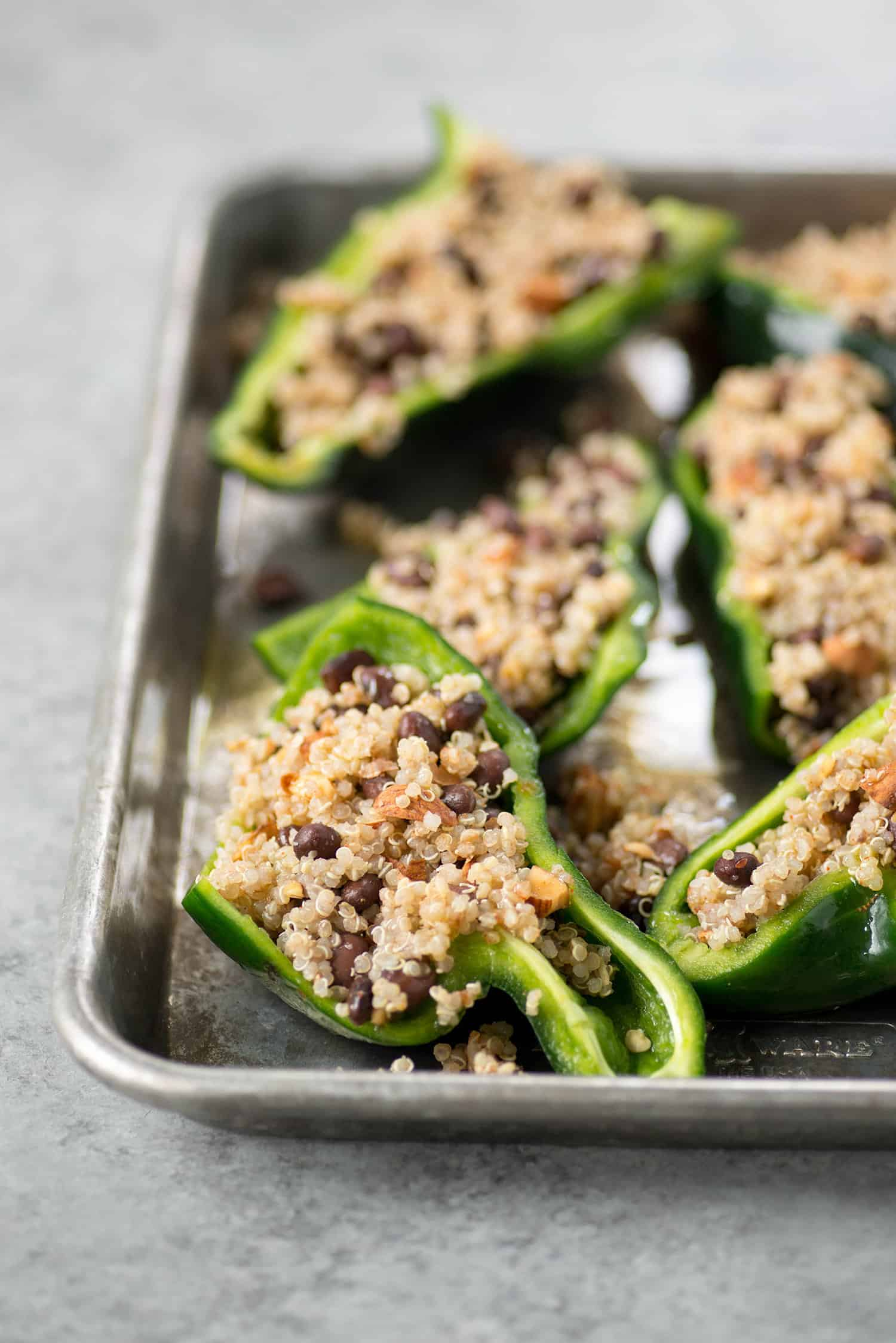 Stuffed Poblanos with Quinoa, Black Beans and a quick mole sauce. We love this healthy vegan and gluten-free dinner. | www.delishknowledge.com