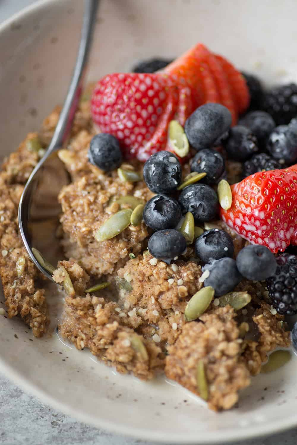 bowl of vegan baked oatmeal with berries