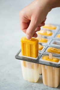 If you love chili salt on fresh mango, then you've gotta try these Sweet Chili Mango Popsicles! Dairy-free, vegan and gluten-free. | www.delishknowledge.com
