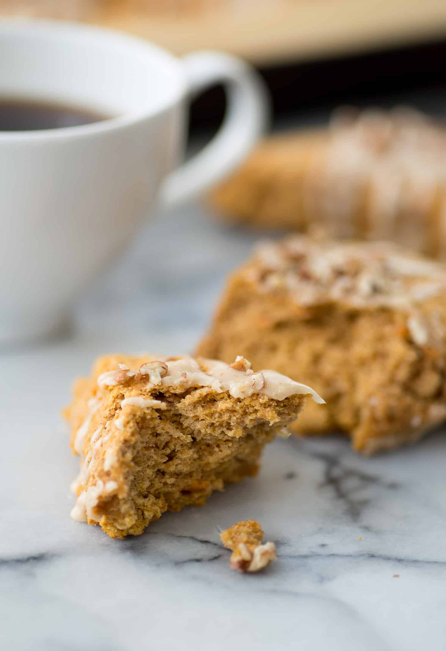 Sweet Potato Pecan Scones with Maple Frosting! You are going to love these healthy, vegan scones! Packed with sweet potato puree, whole wheat-flour and pecans. Drizzled with maple frosting and covered with more pecans. | www.delishknowledge.com