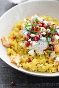 Close-up photo of tandoori cauliflower and turmeric basmati rice.