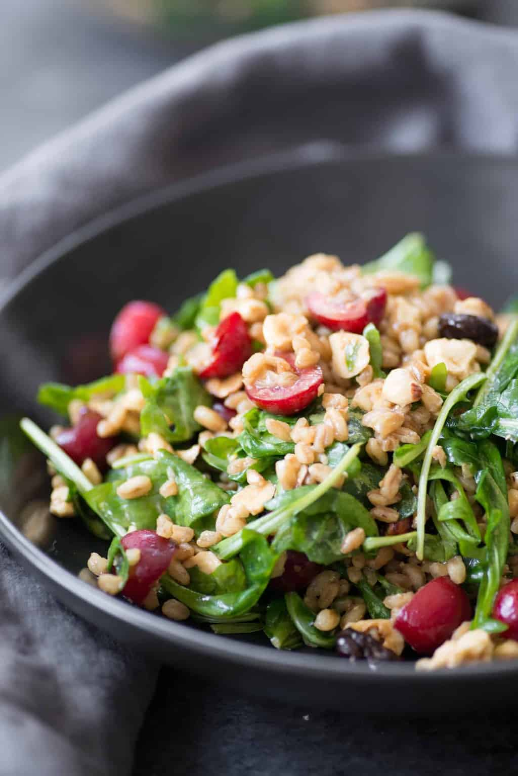 You've gotta try this sweet cherry and farro salad! A delicious potluck salad for summer. Fresh cherries, farro, arugula, hazelnuts, feta and a tangy molasses dressing. Vegetarian. | www.delishknowledge.com