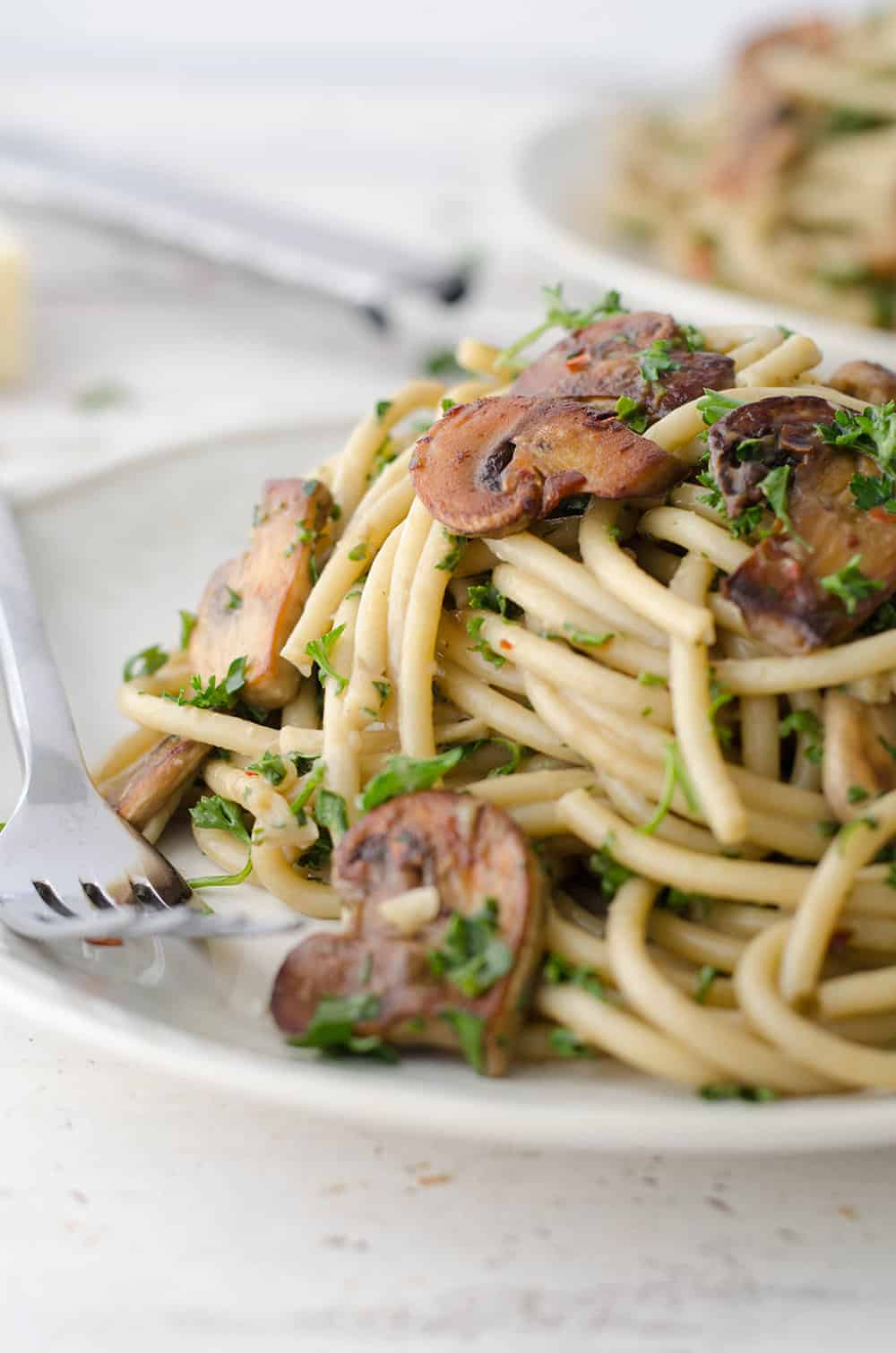 The BEST creamy mushroom pasta! Made with a secret ingredient, this pasta is packed with savory umami flavor and ready in just 20 minutes! Save this for weeknight dinners. | www.delishknowledge.com