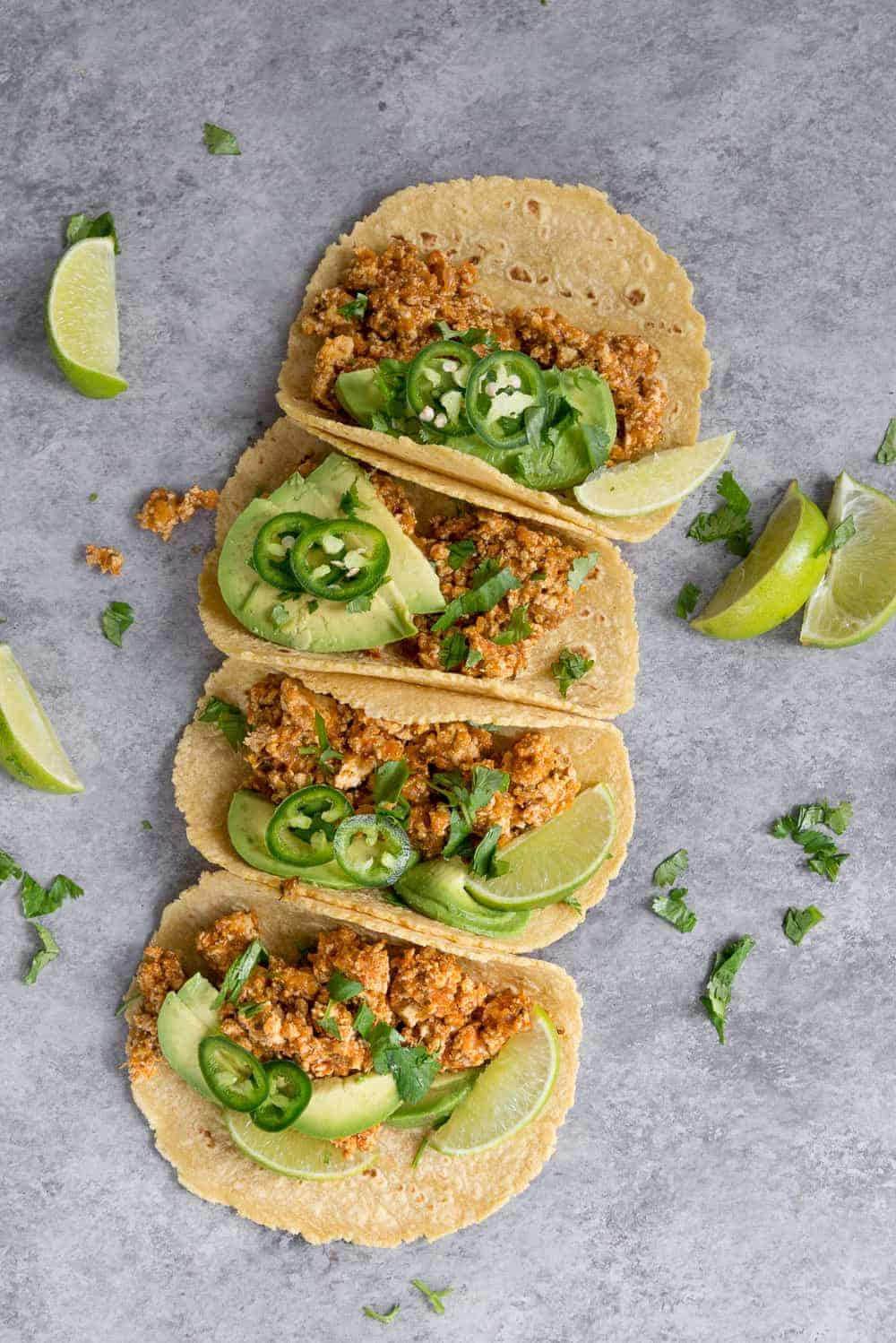 Garnish your Tinga tacos with fresh sliced avocado, jalapeños and a drizzle of lime juice