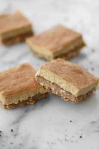 Vegan Espresso Cheesecake Bars! You will LOVE these creamy, dairy-free cheesecake bars. An almond and walnut crust topped with a creamy espresso vanilla cheesecake filling. A must-make for the holidays! | www.delishknowledge.com