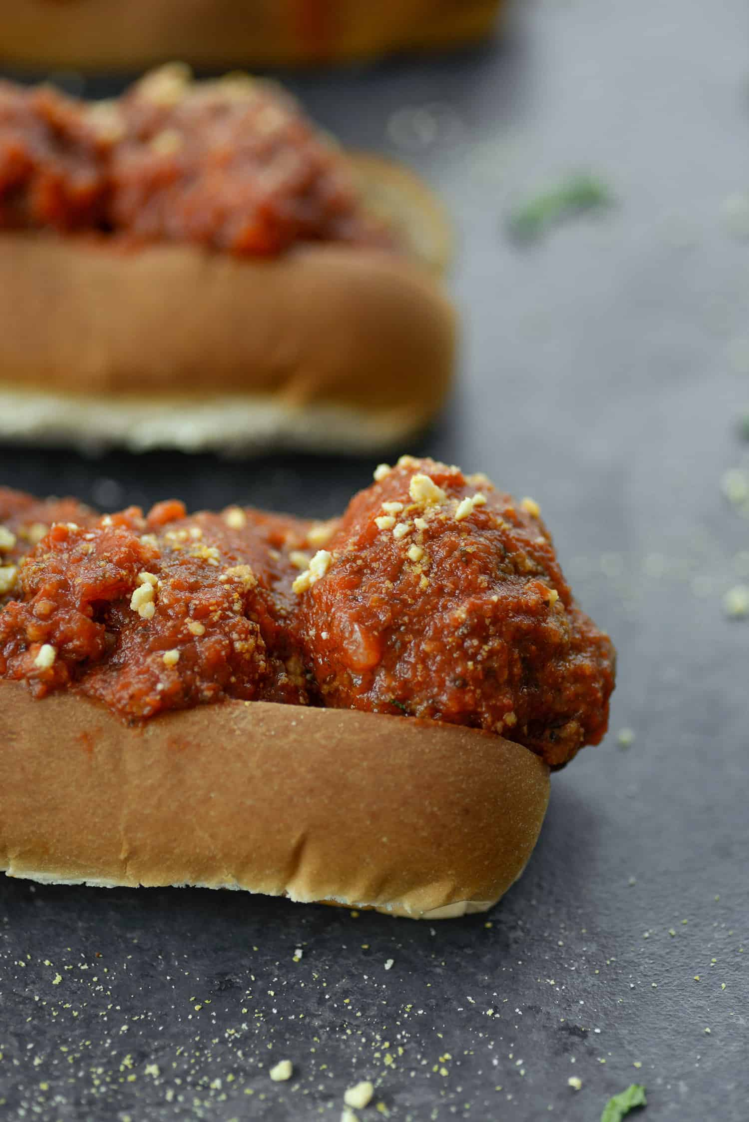 Vegan Meatball Sandwiches! If you love meatball sandwiches, then you've gotta try this vegan version. Chickpea meatballs smothered in marinara sauce and homemade vegan parmesan. Meatballs freeze well! | www.delishknowledge.com