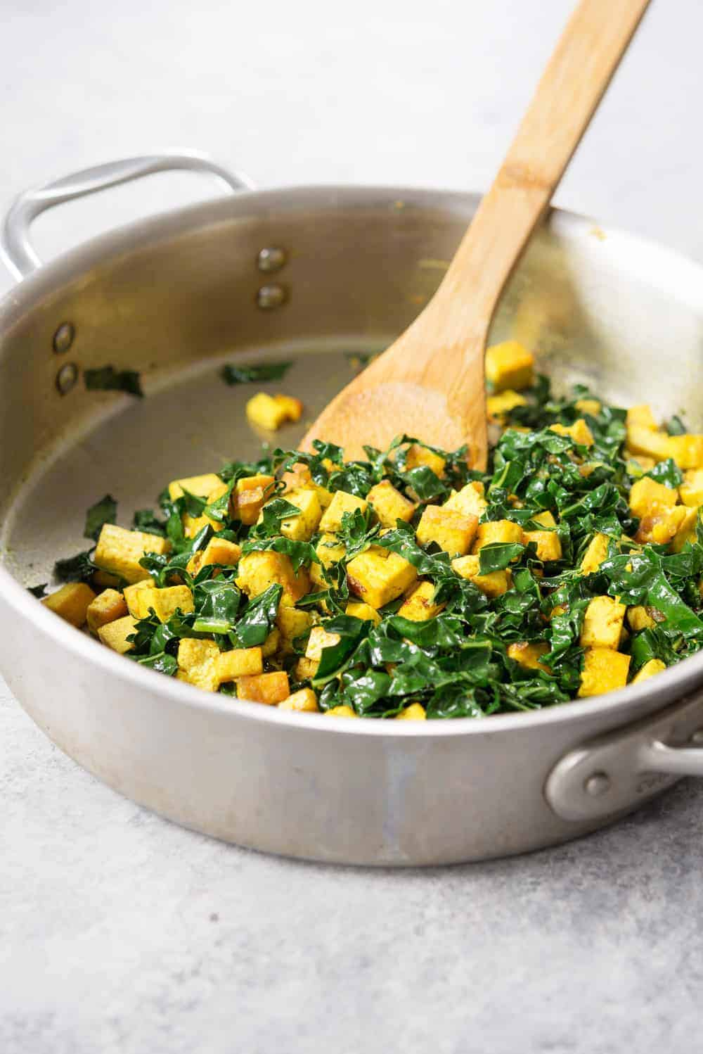kale and tofu in a skillet