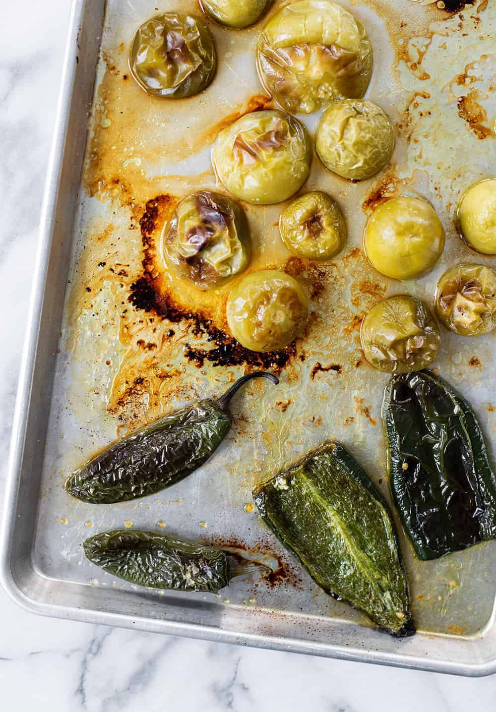 sheet pan of roasted tomatillos, jalapenos and poblano peppers
