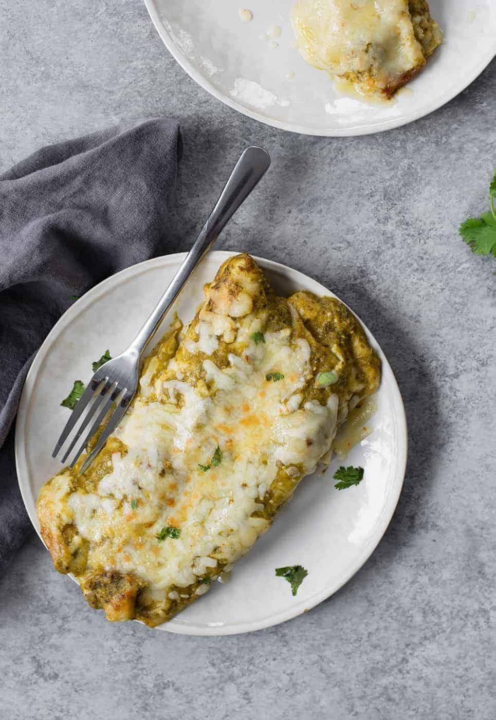 Enchiladas verdes with mushrooms, beans and spinach