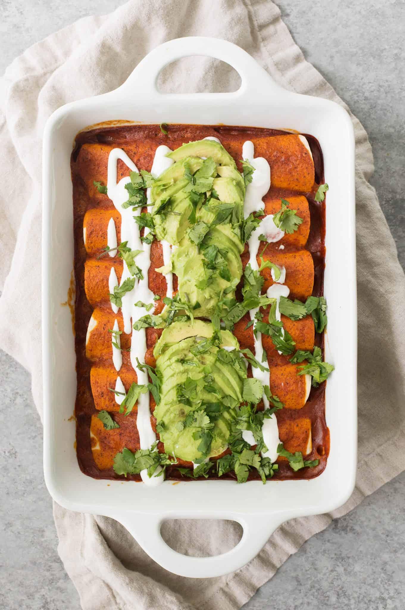 top view of vegetarian enchiladas in white pan