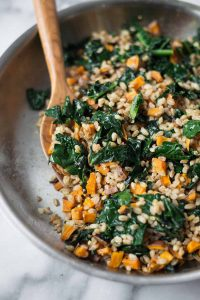 Warm Farro, Squash and Kale Salad with Orange-Miso Dressing! This vegan meal is super nourishing and healthy. Roasted squash sauteed with kale and farro, then tossed in a silky orange and miso dressing. A must make this winter! | www.delishknowledge.com