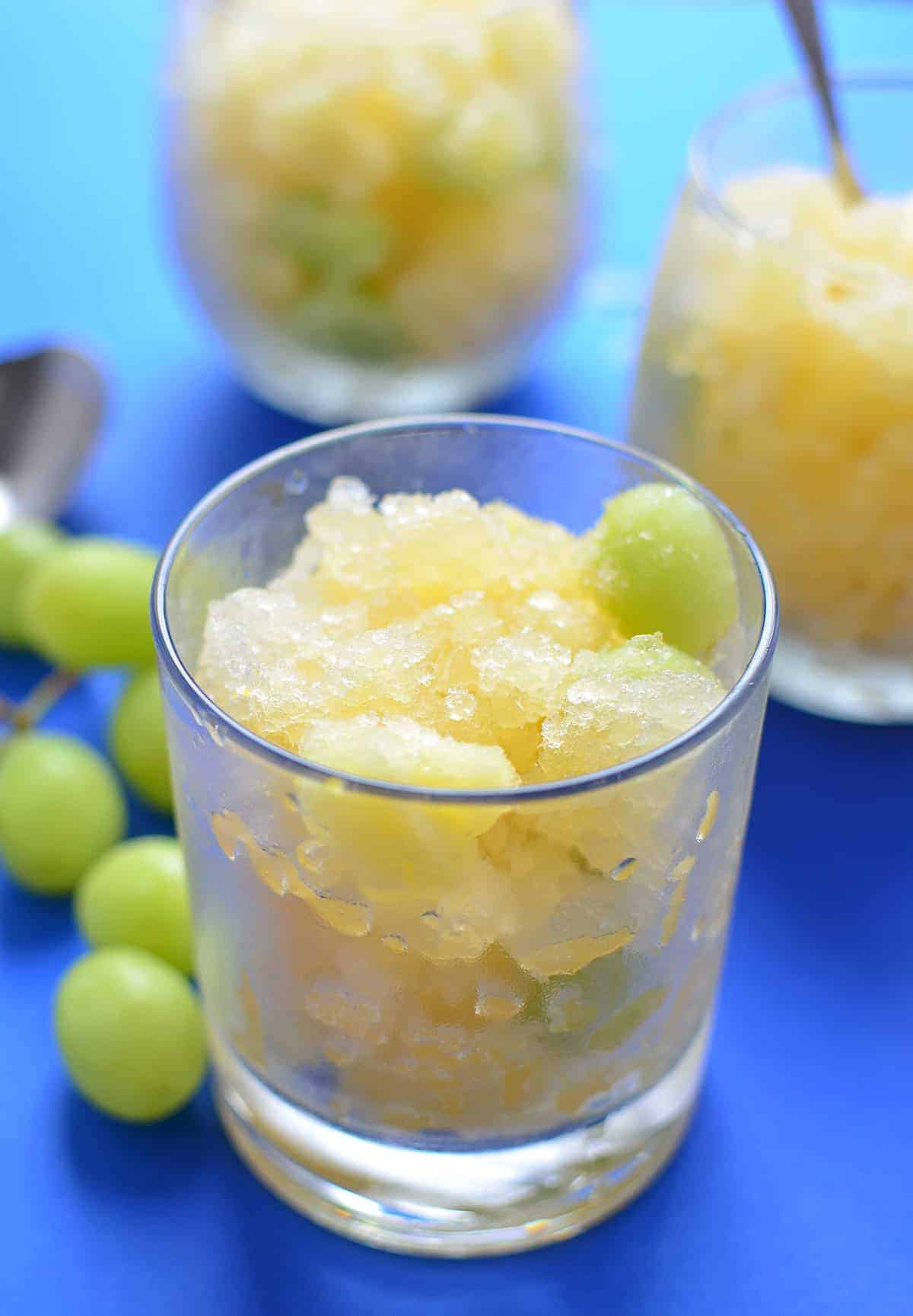 White Sangria Slush! One part sno-cone, one part healthy dessert. Serve this at your next cookout to please both the kids AND the adults. Vegan, Gluten-Free, Naturally sweetened. | www.delishknowledge.com