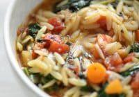 close up bowl of vegan kale and orzo soup
