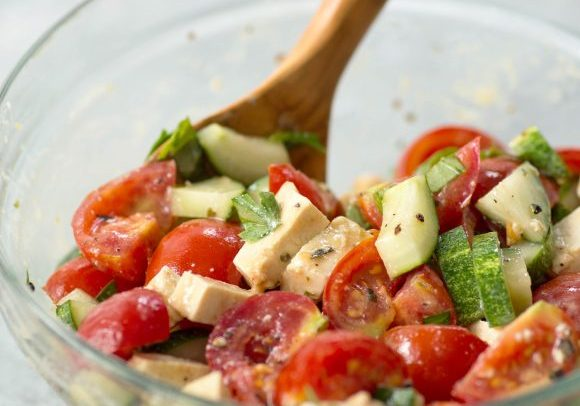 Simple Tomato and Tofu Feta Salad! This salad is so simple and easy; tomatoes, cucumbers, basil, parsley and homemade tofu feta. Vegan and gluten-free | www.delishknowledge.com