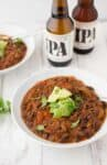 Black Bean & Beer Chili! A hearty vegetarian chili loaded with mushrooms, beans, peppers and simmered in a tangy beer sauce. Vegan and Gluten-free| www.delishknowledge.com