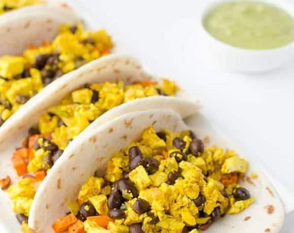 Vegan breakfast tacos! High protein and full of fiber: pepper scramble, roasted sweet potatoes and avocado-verde sauce