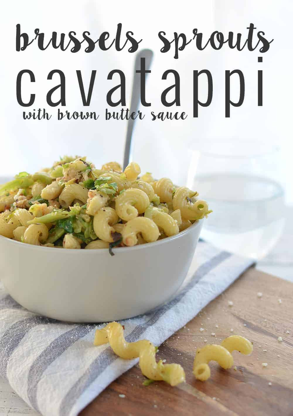 Brussels Sprout and Brown Butter Pasta! A must-make this holiday, so simple and delicious! Crispy brussels sprouts tossed with crunchy nuts, cheese, pasta and browned butter. | www.delishknowledge.com